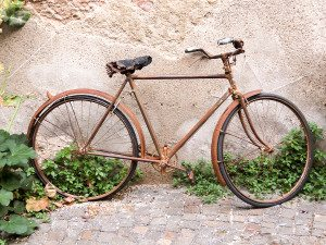 Old rusty vintage bicycle near the concrete wall ** Note: Visible grain at 100%, best at smaller sizes